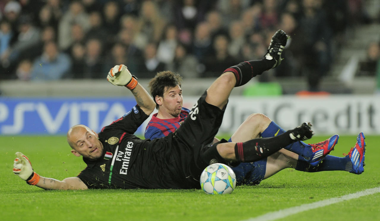 Barcelona's Argentinian forward Lionel Messi (R) fights for the ball with AC Milan's goalkeeper Chistian Abbiati during the Champions League quarter-final second leg football match FC Barcelona vs AC Milan on April 3, 2012 at Camp Nou stadium in Barcelona. FC Barcelona defeated AC Milan 3-1 to reach the semi-finals.         AFP PHOTO / JOSEP LAGO (Photo credit should read JOSEP LAGO/AFP/Getty Images)