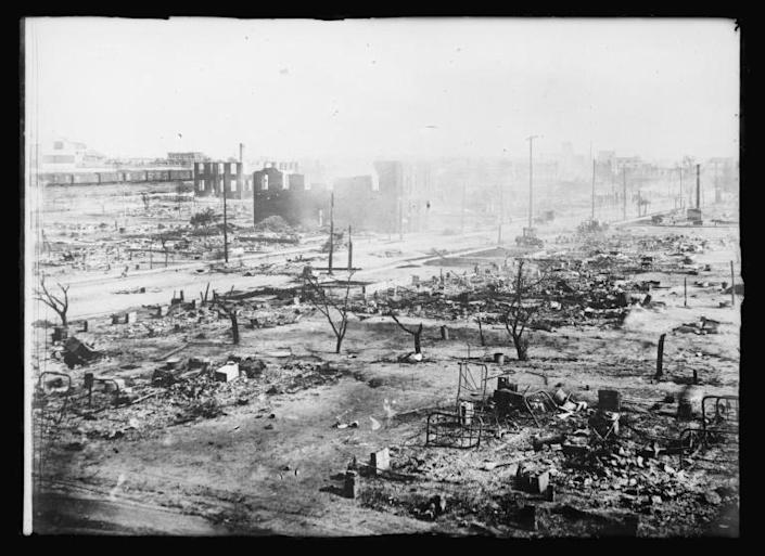 This image obtained from the American National Red Cross photograph collection at the US Library of Congress, the smoldering ruins of Tulsa, Oklahoma's black Greenwood district after white mobs attacked May 31-June 1, 1921 (AFP Photo/-)