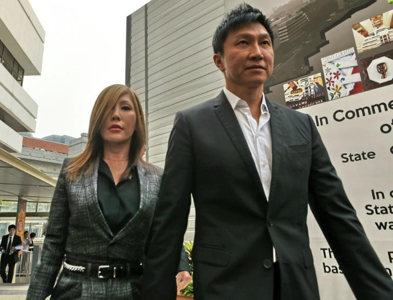 City Harvest Church founder Kong Hee (R) has had his jail sentence for misusing church funds to boost the career of his pop-singer wife Ho Yeow Sun (L)  reduced on appeal