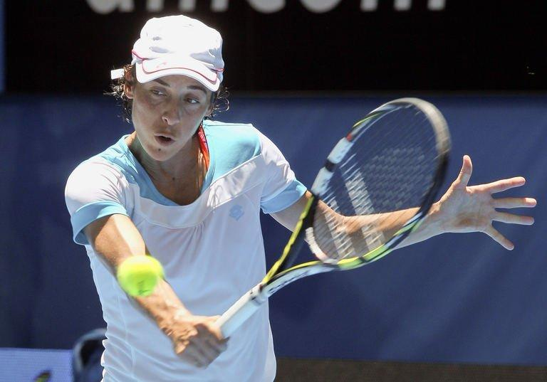 Francesca Schiavone hits a return against Tatjana Malek during their singles match at the Hopman Cup on January 2, 2013
