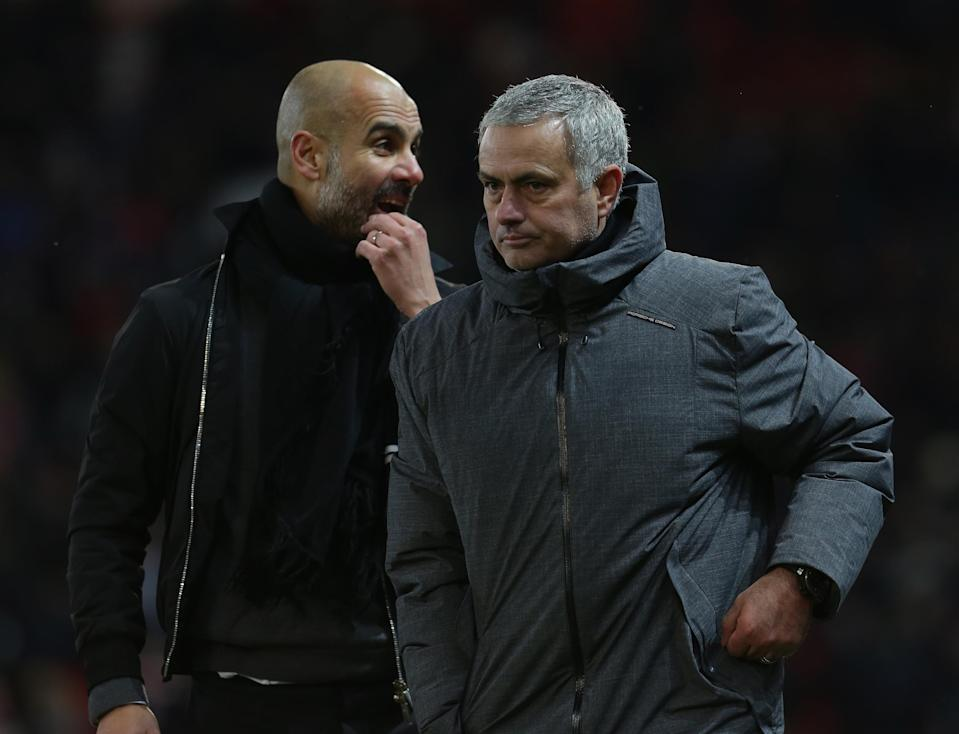 Jose Mourinho and Pep Guardiola on the Old Trafford sideline during Manchester City's 2-1 victory over Manchester United. (Getty)
