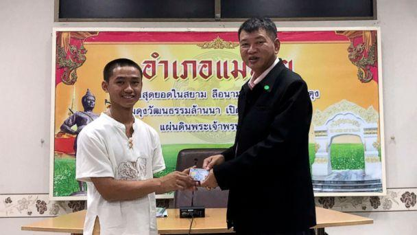 PHOTO: Adul Sam-on, left, receives an identity card denoting Thai citizenship from Somsak Kunkam, Sheriff of Mae Sai during a ceremony in Chiang Rai province, Thailand, Aug. 8, 2018. (Chiang Rai Public Relations Office via AP)
