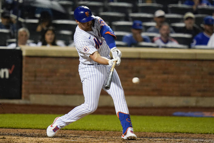New York Mets' Brandon Drury hits an RBI-single during the sixth inning of a baseball game against the Chicago Cubs, Monday, June 14, 2021, in New York. (AP Photo/Frank Franklin II)