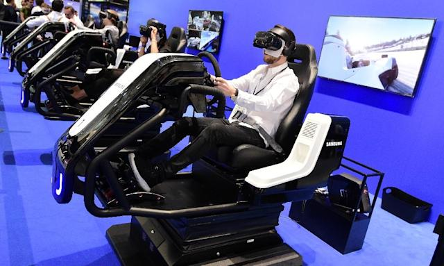Visitors test virtual reality glasses at the 2018 IFA trade show in Berlin (AFP Photo/Tobias SCHWARZ)