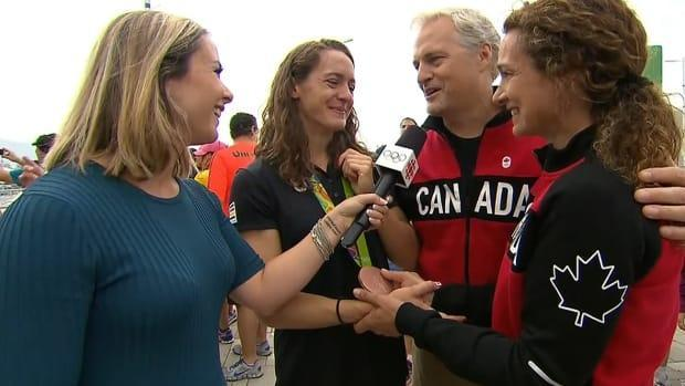 CBC Sports' Andi Petrillo, pictured here interviewing swimmer Sandrine Mainville and her parents at the 2016 Rio Olympics, says she'll miss the emotional aspect of meeting face-to-face with Canada's medal hopefuls and their families in Tokyo this summer as the network will host from Toronto amid a global pandemic. (CBC Sports - image credit)
