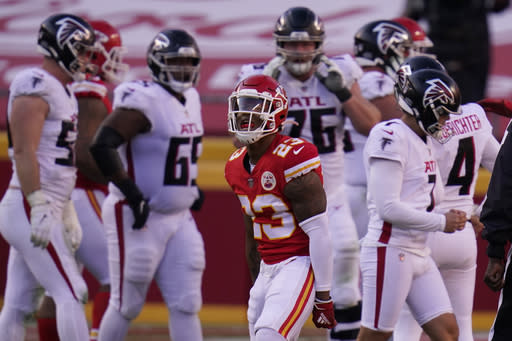 Kansas City Chiefs safety Armani Watts (23) reacts after Atlanta Falcons place kicker Younghoe Koo, right) missed a 39-yard field goal during the second half of an NFL football game, Sunday, Dec. 27, 2020, in Kansas City. The Chiefs defeated the Falcons 17-14. (AP Photo/Jeff Roberson)