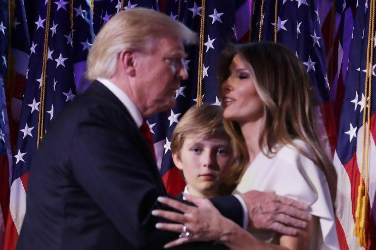 President-elect Donald Trump embraces his wife, Melania Trump, as their son, Barron, looks on. (Photo: Chip Somodevilla/Getty Images)