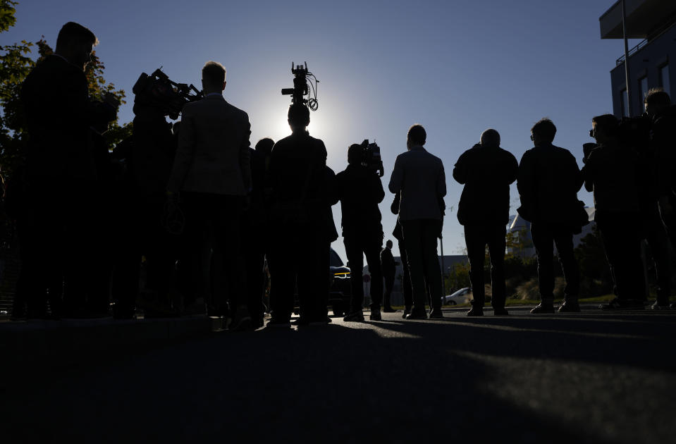 Journalists wait for arrival Czech Republic's Prime Minister and leader of centrist ANO (YES) movement Andrej Babis near his election headquarters, Prague, Czech Republic, Saturday, Oct. 9, 2021. After votes from almost 30% of the country's 14,900 ballot stations were counted Saturday by the Czech Statistics Office, ANO has received 30.1% of the vote. (AP Photo/Petr David Josek)