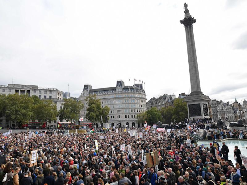 Protesters gather today in Trafalgar Square in London, at a 'We Do Not Consent!' mass rally against vaccination and government restrictions designed to fight the spread of the novel coronavirus (AFP via Getty Images)