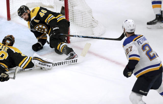Boston Bruins' David Krejci, center, of the Czech Republic, stops a shot by St. Louis Blues' Alex Pietrangelo, right, as Bruins goaltender Tuukka Rask, left, of Finland, sprawls on the iceduring the second period in Game 5 of the NHL hockey Stanley Cup Final, Thursday, June 6, 2019, in Boston. (AP Photo/Charles Krupa)