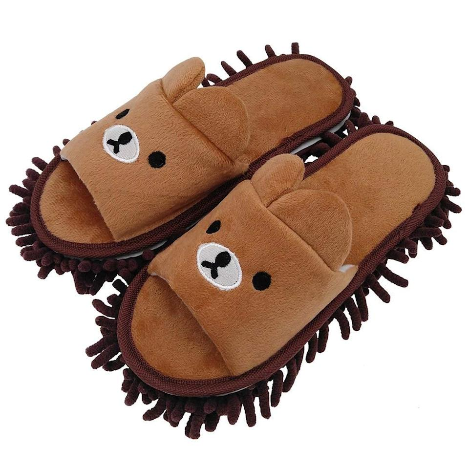 """<p>Keep your feet cozy and the floor clean with these <a href=""""https://www.popsugar.com/buy/Selric-Microfiber-Washable-Mop-Slippers-396455?p_name=Selric%20Microfiber%20Washable%20Mop%20Slippers&retailer=amazon.com&pid=396455&price=13&evar1=savvy%3Auk&evar9=45588360&evar98=https%3A%2F%2Fwww.popsugar.com%2Fsmart-living%2Fphoto-gallery%2F45588360%2Fimage%2F45589386%2FSelric-Microfiber-Washable-Mop-Slippers&list1=shopping%2Cgifts%2Camazon%2Choliday%2Cchristmas%2Cgift%20guide&prop13=api&pdata=1"""" rel=""""nofollow"""" data-shoppable-link=""""1"""" target=""""_blank"""" class=""""ga-track"""" data-ga-category=""""Related"""" data-ga-label=""""https://www.amazon.com/dp/B07H29GHHH/ref=cm_gf_aAN_i3_d_p0_qd13______________________YrtsZwyJhAqsiaz9eZDK"""" data-ga-action=""""In-Line Links"""">Selric Microfiber Washable Mop Slippers</a> ($13). </p>"""