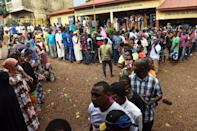 Voters queue at a polling station in Conakry on Sunday