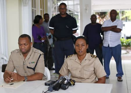 Jamaica Coast Guard Lieutenant Commander Judy-Ann Neil (R) and Senior Police Superintendent Terrence Bent give a news conference on the status of their search for a small U.S. private plane with an unresponsive pilot that crashed off the east coast of Jamaica, at the Errol Flynn Marina in Port Antonio September 6, 2014. REUTERS/Gilbert Bellamy