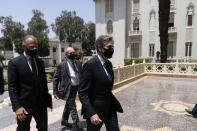 Secretary of State Antony Blinken, right, arrives for a meeting with Egyptian President Abdel-Fattah el-Sissi at the Heliopolis Presidential Palace, Wednesday, May 26, 2021, in Cairo, Egypt. (AP Photo/Alex Brandon, Pool)