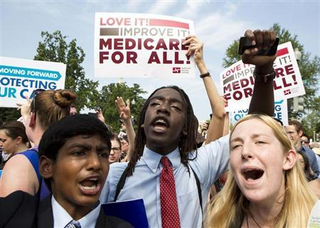 Supporters of the Affordable Healthcare Act celebrate in front of the Supreme Court in Washington