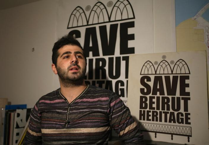 In this April 8, 2014 photo, Naji Raji, an activist and spokesman for Save Beirut Heritage, speaks during an interview with The Associated Press, in Beirut, Lebanon. An initial census in the early 1990s counted 1600 traditional homes and buildings in the greater Beirut area, while today, an estimated 250 standing structures remain, said Raji. Save Beirut Heritage has a hotline through which it receives tips about old buildings threatened with demolitions, which it conveys to the Culture Ministry. This has allowed the group to halt the demolition of up to 60 buildings in Beirut and its suburbs since 2010. (AP Photo/Hussein Malla)