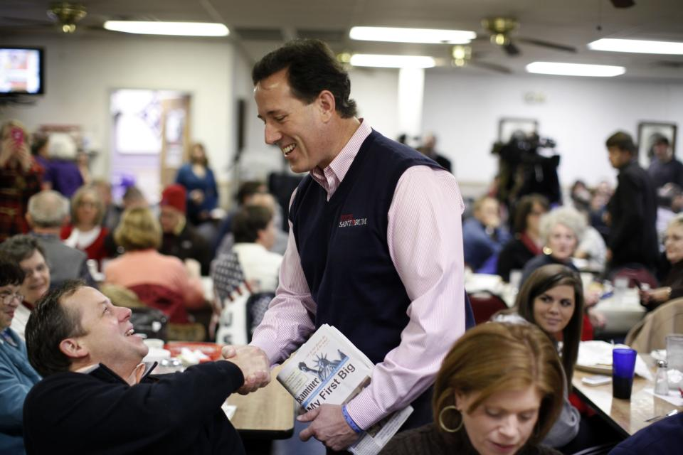 FILE -In this Saturday, Jan. 14, 2012 file photo, Republican presidential candidate, former Pennsylvania Sen. Rick Santorum, meets patrons of Tommy's Ham House during a campaign event in Greenville, S.C. The Greenville landmark says it is turning off the fryer and shutting its doors. Owner Tommy Stevenson announced Sunday that Tommy's Country Ham House would close this spring. (AP Photo/Matt Rourke, File)