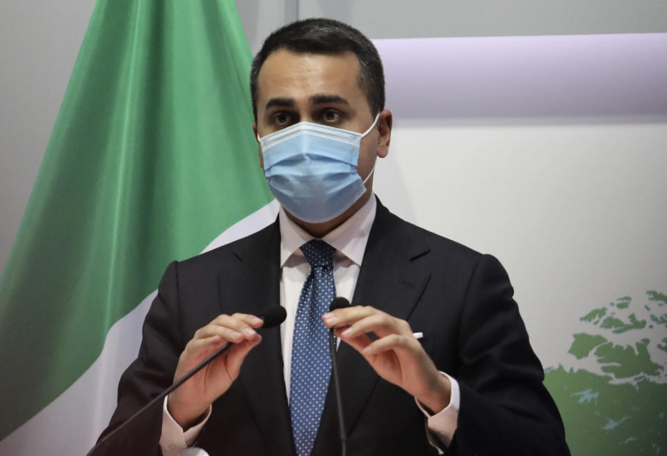 Italian Foreign Minister Luigi Di Maio adjusts the microphones as he speaks to the media during a press conference after a meeting with Cypriot Foreign Minister Nicos Christodoulides at the Foreign Ministry house in Nicosia, Cyprus, Tuesday, March 9, 2021. Maio is in Cyprus on a one-day visit. (Yiannis Kourtoglou Pool via AP)