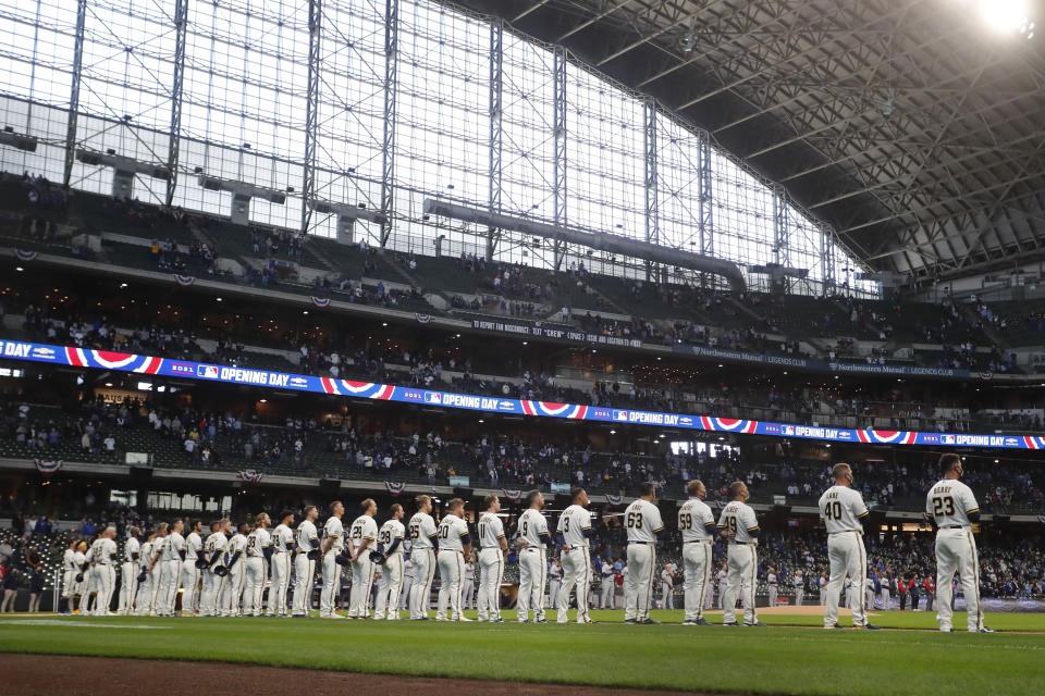 Members of the Milwaukee Brewers line up before an opening day baseball game against the Minnesota Twins, Thursday, April 1, 2021, in Milwaukee. (AP Photo/Aaron Gash)