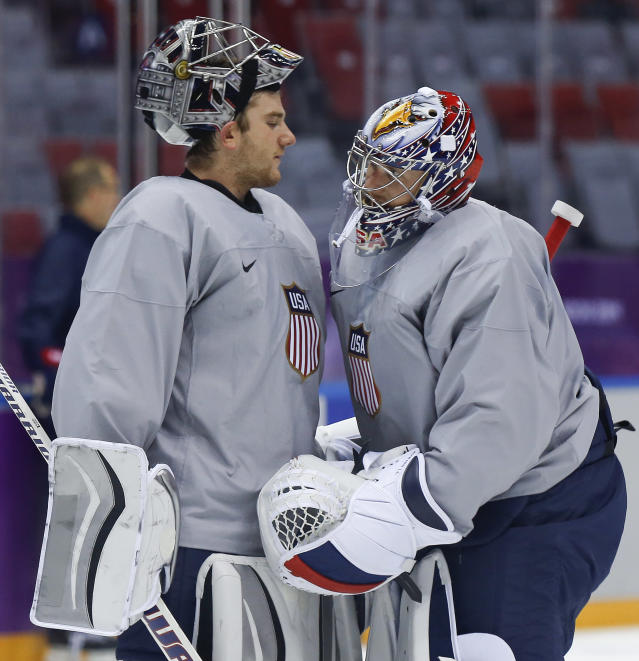 USA goaltender Jonathan Quick, left, talks with goaltender Jimmy Howard during a training session at the 2014 Winter Olympics, Monday, Feb. 10, 2014, in Sochi, Russia. (AP Photo/Julie Jacobson)