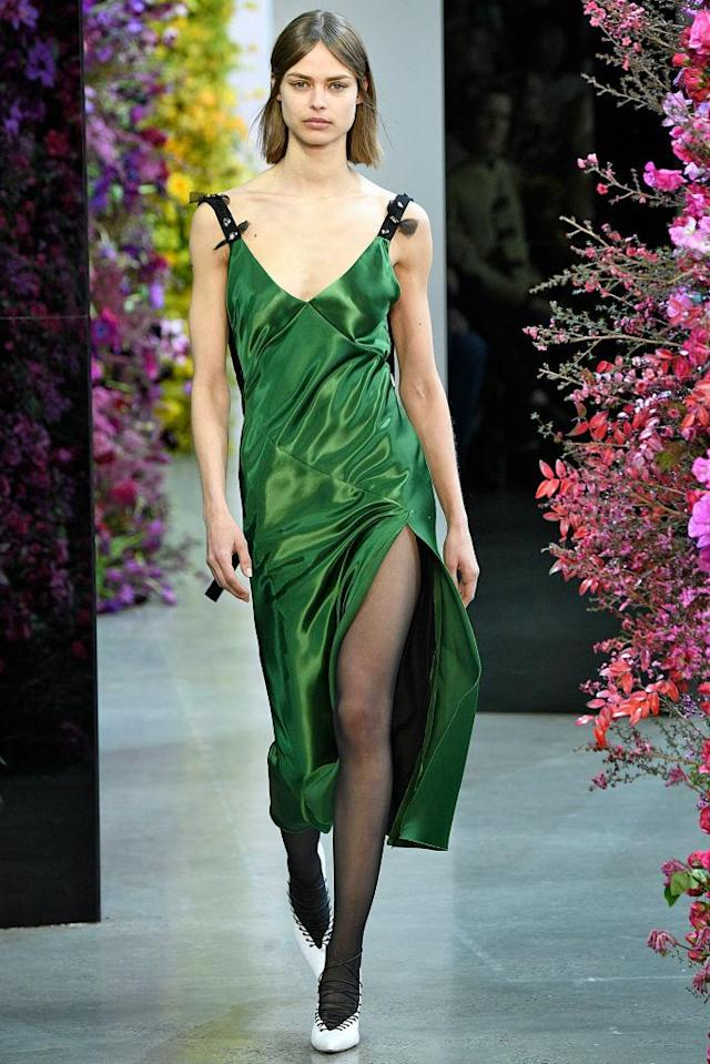 <p>A model wears a green silk dress at the Jason Wu FW18 show. (Photo: Getty) </p>