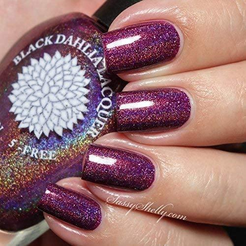 <p>Get creative with your manicures with the <span>Black Dahlia Lacquer in Berry Birthday</span> ($12). This gorgeous royal-purple holographic shade will make a statement.</p>