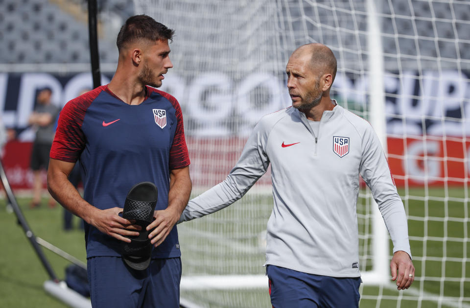United States head coach Gregg Berhalter (R) talks to defender Matt Miazga (L) as they arrive for a training session at Soldier Field on July 6, 2019 in Chicago, Illinois, a day before the 2019 Concacaf Gold Cup final between Mexico and United States. (Photo by KAMIL KRZACZYNSKI / AFP)        (Photo credit should read KAMIL KRZACZYNSKI/AFP/Getty Images)