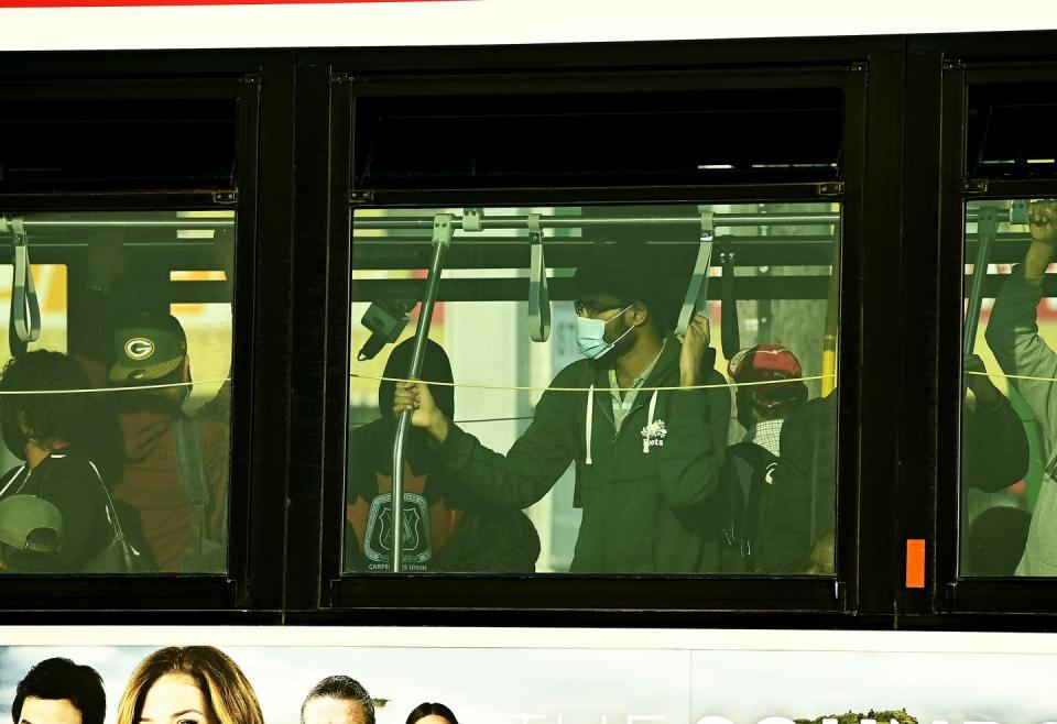 """<span class=""""caption"""">People are shoulder to shoulder inside a city bus while commuting at rush hour during the COVID-19 pandemic in Toronto. </span> <span class=""""attribution""""><span class=""""source"""">THE CANADIAN PRESS/Nathan Denette </span></span>"""