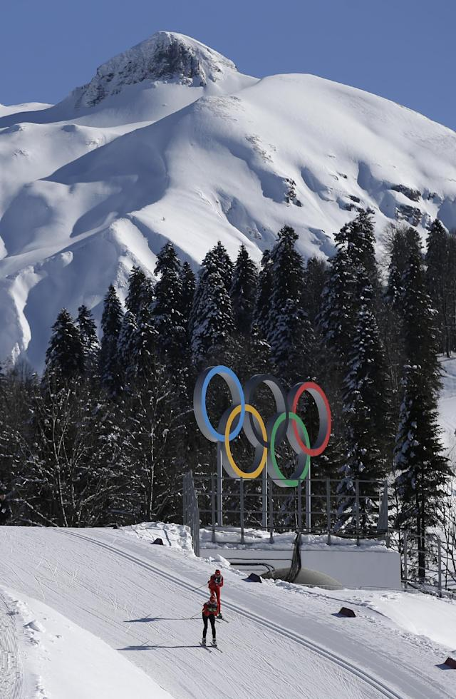 Cross country skiers pass by the Olympic rings as they train for the 2014 Winter Olympics, Tuesday, Feb. 4, 2014, in Krasnaya Polyana, Russia. (AP Photo/Gregorio Borgia)