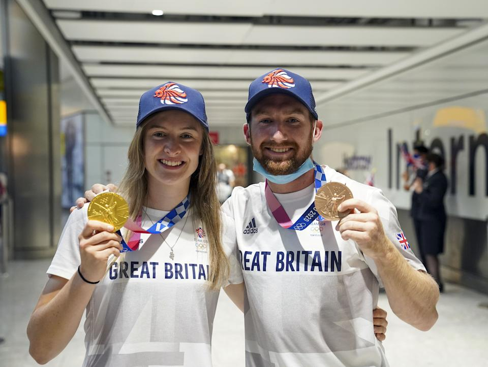 Charlotte Worthington who won gold in the BMX Freestyle and Declan Brooks who won bronze arrive back at London Heathrow Airport from the Tokyo 2020 Olympic Games. Picture date: Tuesday August 3, 2021.