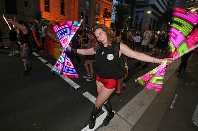 <p>A woman twirls lights as members of the gay community and their supporters celebrate the result of a postal survey calling for gay marriage right in Sydney, Australia, Wednesday, Nov. 15, 2017. (Photo: Rick Rycroft/AP) </p>