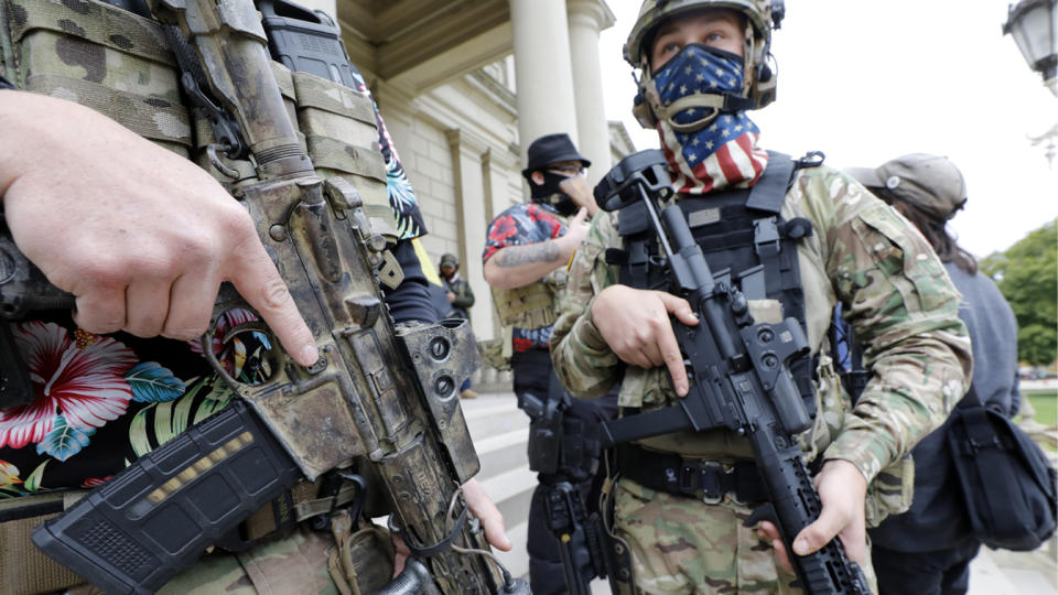 A group tied to the Boogaloo Bois holds a rally as they carry firearms at the Michigan State Capitol in Lansing, Michigan on October 17, 2020. (Jeff Kowalsky/AFP via Getty Images)