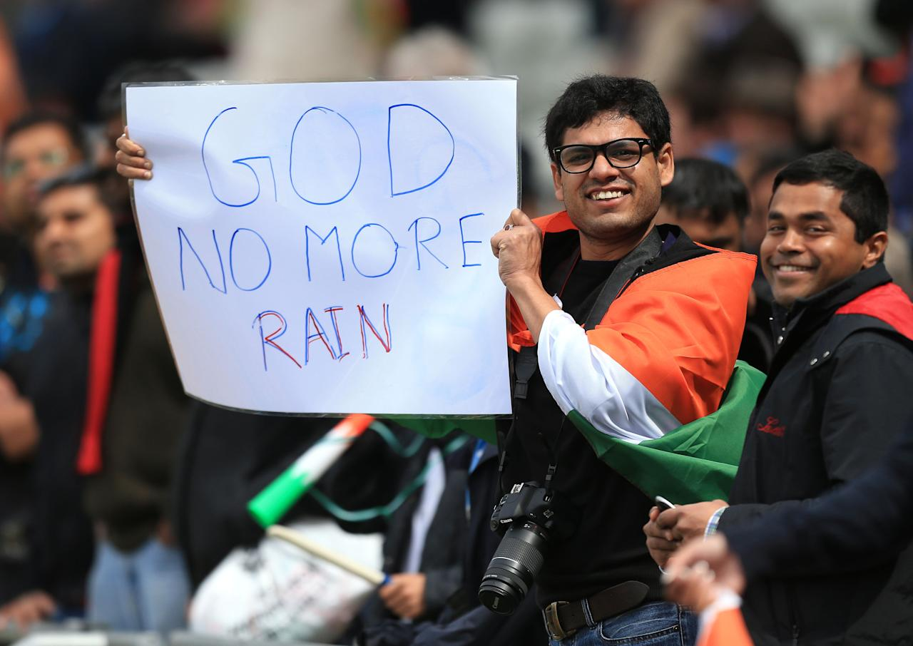 An Indian fans holds a sign asking for no more rain during the ICC Champions Trophy Final at Edgbaston, Birmingham.