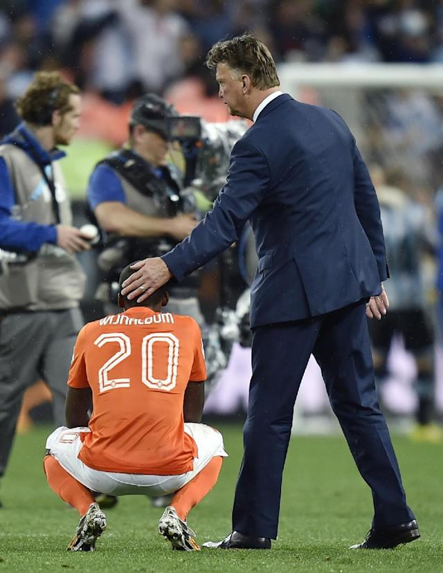 Netherlands' head coach Louis van Gaal consoles Netherlands' Georginio Wijnaldum after a shootout at the end of the World Cup semifinal soccer match between the Netherlands and Argentina at the Itaquerao Stadium in Sao Paulo Brazil, Wednesday, July 9, 2014. Argentina won 4-2 on penalties after the match ended 0-0 after extra time. (AP Photo/Martin Meissner)