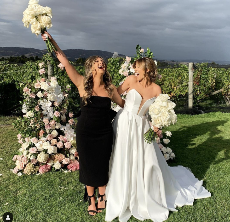 Georgia Love and her bridesmaid laughing