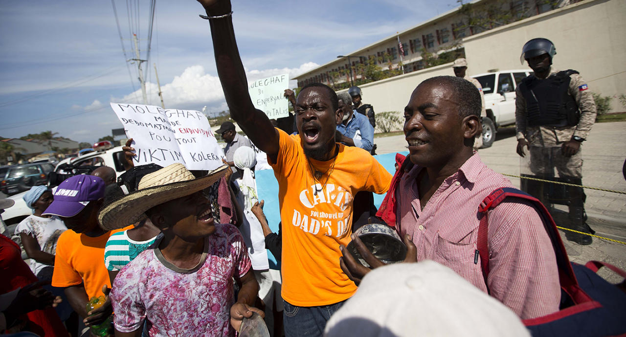 <p>Demonstrators chant outside the U.S. Embassy in Haiti during a protest against President Trump's recent disparaging comments. (AP) </p>