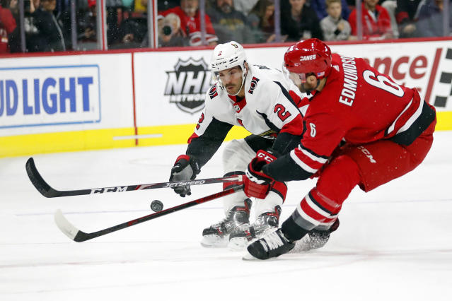Ottawa Senators' Dylan DeMelo (2) battles with Carolina Hurricanes' Joel Edmundson (6) during the first period of an NHL hockey game in Raleigh, N.C., Monday, Nov. 11, 2019. (AP Photo/Karl B DeBlaker)