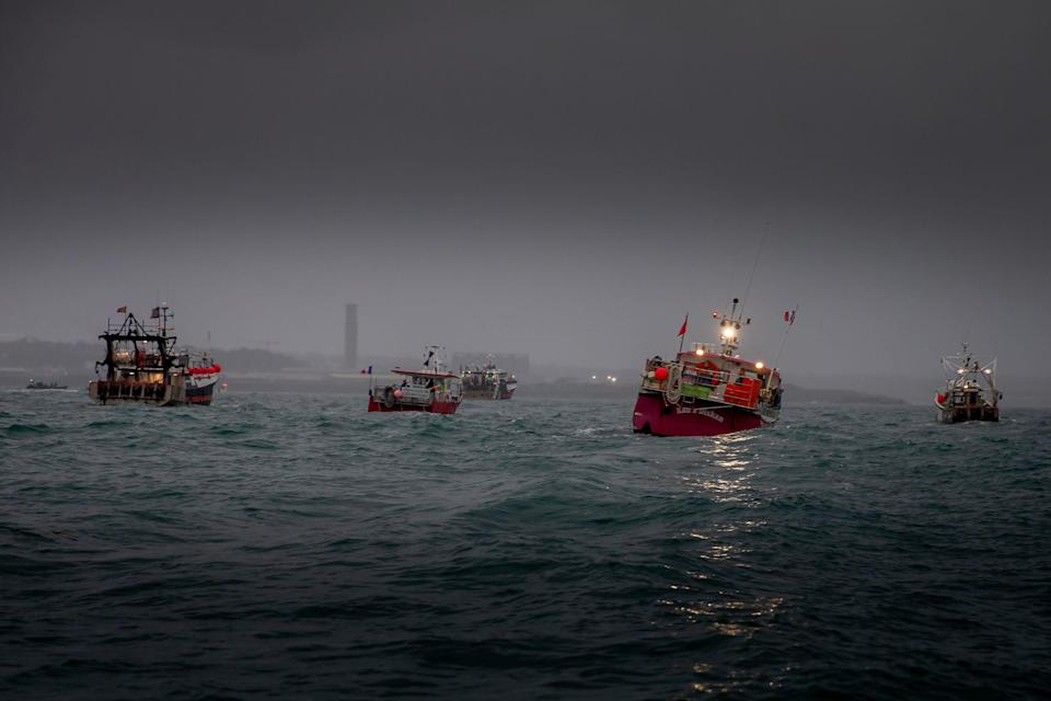 <p>French fishing vessels stage a protest at St Helier</p> (PA)