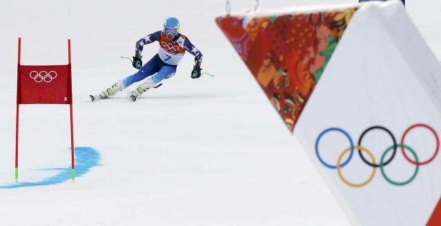 Ted Ligety of the U.S. competes in the first run of the men's alpine skiing giant slalom event in the Sochi 2014 Winter Olympics at the Rosa Khutor Alpine Center February 19, 2014. REUTERS/Mike Segar (RUSSIA - Tags: OLYMPICS SPORT SKIING)