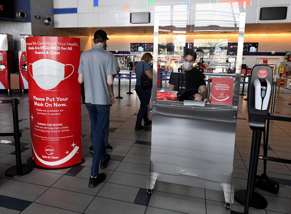 <p>Guests enter AMC Town Square 18 on August 20 in Las Vegas, Nevada.</p>