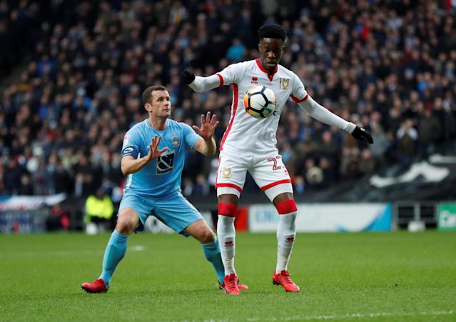 Soccer Football - FA Cup Fourth Round - Milton Keynes Dons vs Coventry City - Stadium MK, Milton Keynes, Britain - January 27, 2018 MK Dons' Ike Ugbo in action with Coventry's Michael Doyle Action Images/Andrew Boyers