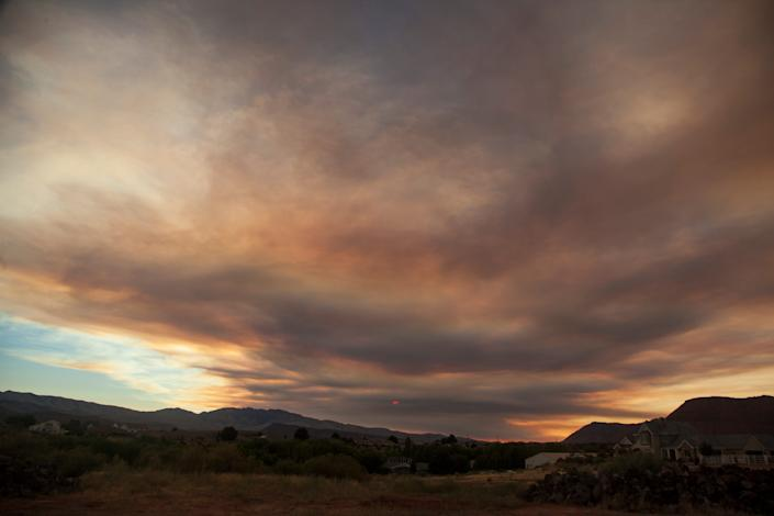 Smoke from the Bishop Fire drifts over southwestern Utah Wednesday, July 29, 2020.
