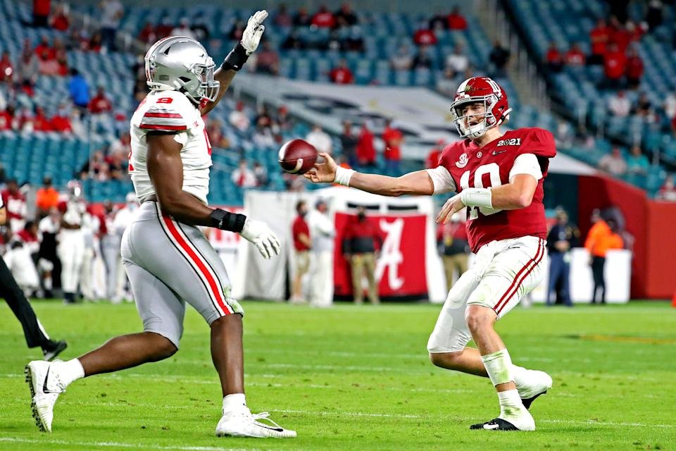 Alabama quarterback Mac Jones passes against Ohio State defensive end Zach Harrison during the College Football Playoff national championship game, Jan 11, 2021 in Miami Gardens, Fla.