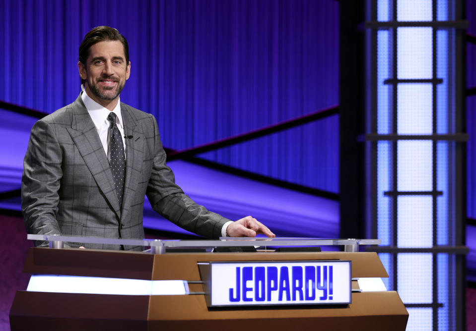 This image released by Jeopardy Productions, Inc. shows Green Bay Packers quarterback Aaron Rodgers as he guest hosts the game show
