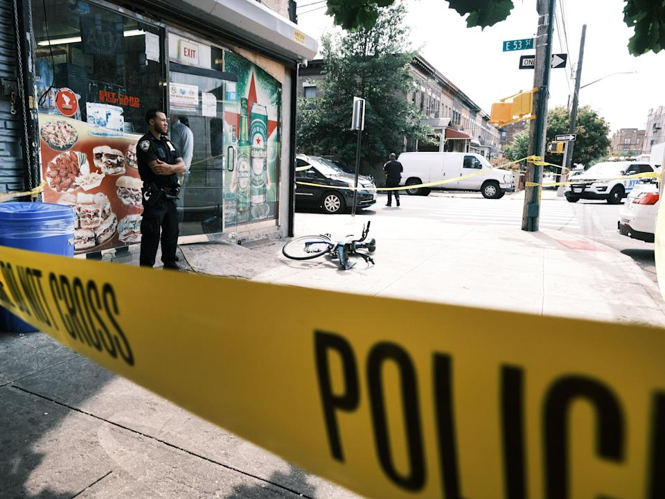 Police converge on the scene of a shooting in Brooklyn, one of numerous during the day, on July 14, 2021 in New York City (Getty Images)