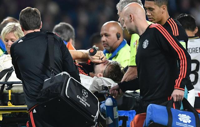 Manchester's defender Luke Shaw receives treatment after an injury during the UEFA Champions League Group B football match between PSV Eindhoven and Manchester United at the Philips stadium in Eindhoven, the Netherlands, on September 15, 2015 (AFP Photo/John Thys)