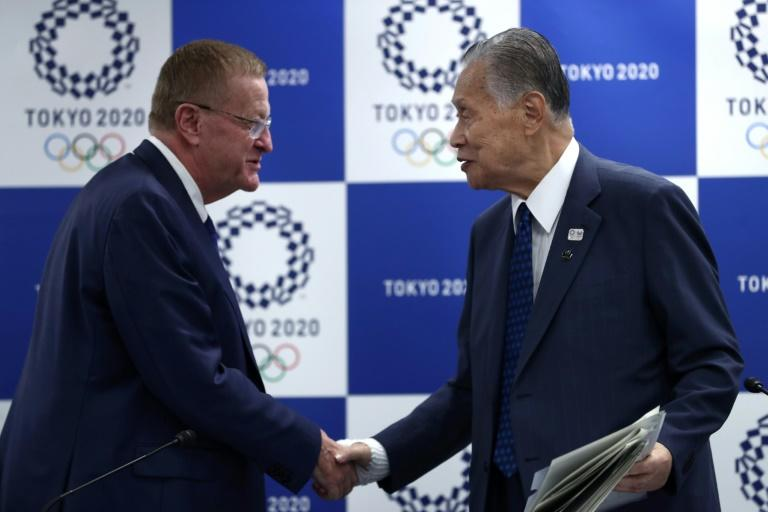 The IOC coordination commission chief John Coates (L) gave an unequivocal answer when asked if he supported an appeal to introduce daylight savings during Tokyo 2020, amid fears athletes and fans could be at risk