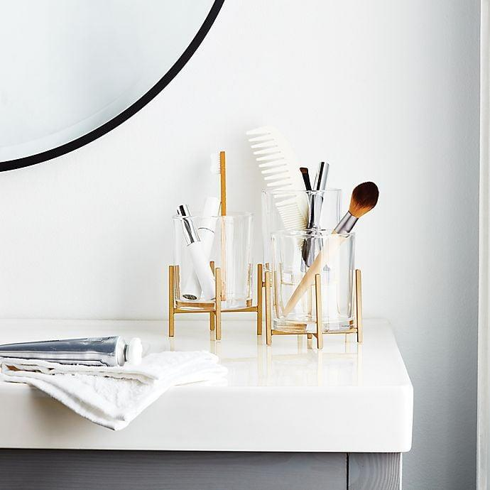 <p>The <span>O&amp;O by Olivia &amp; Oliver Triple Cup Cosmetic Organizer</span> ($23, originally $30) are so chic.</p>