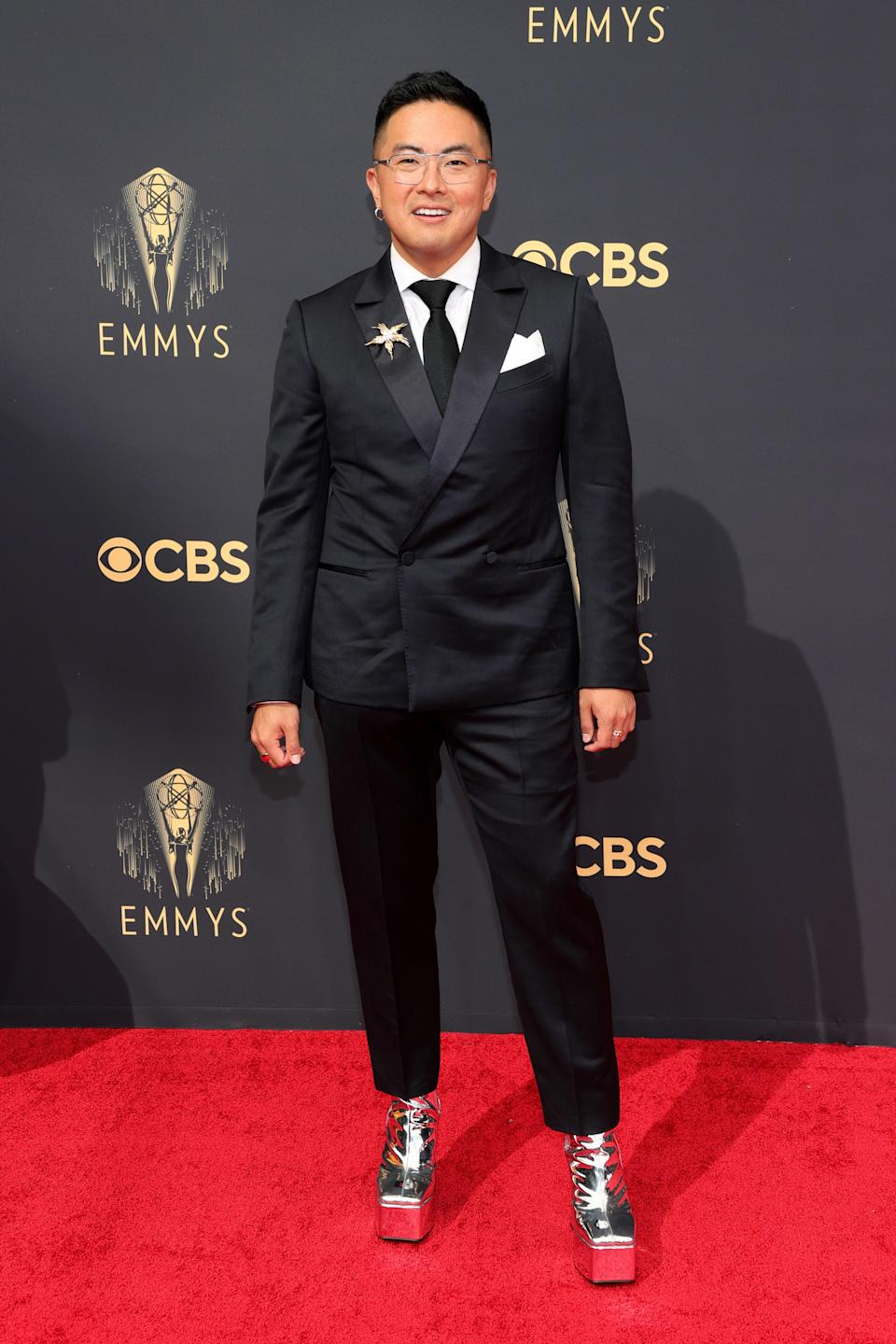 The <em>SNL</em> star went for the statement look in a black Zegna tux with cropped pants to show off his silver Syro platform boots. He added another touch of sparkle with a Tiffany brooch pinned to the tux jacket's lapel.