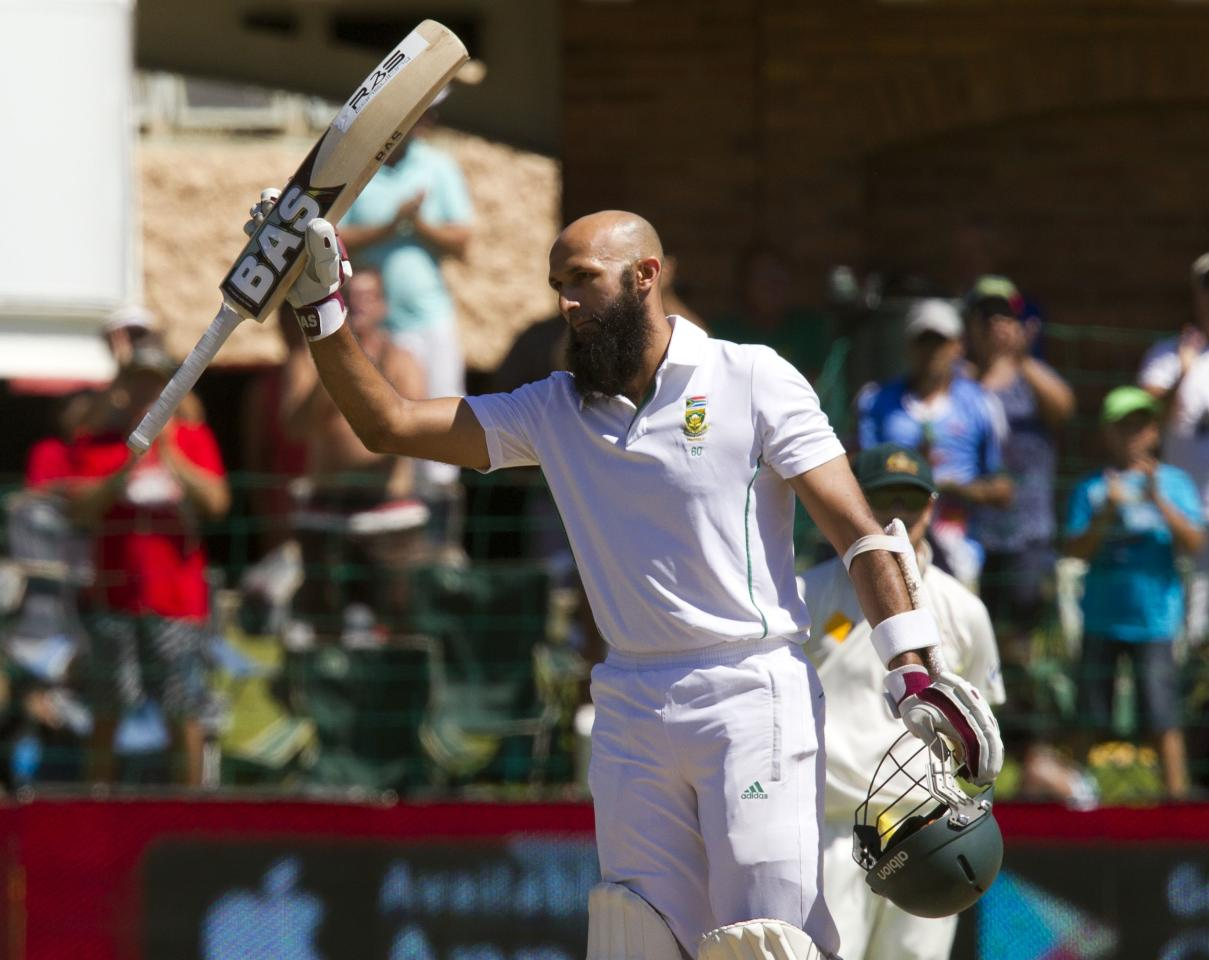 REFILE - CORRECT DAY OF PLAY  South Africa's Hashim Amla celebrates scoring a century during the fourth day of the second cricket test match against Australia in Port Elizabeth, February 23, 2014. REUTERS/Rogan Ward (SOUTH AFRICA - Tags: SPORT CRICKET)